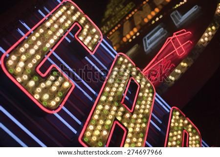 Illuminated neon signs of unitendified casinos in Las Vegas - stock photo