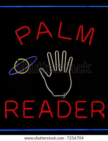 Illuminated palm reader neon sign on black - stock photo