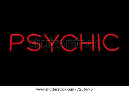 Illuminated red psychic neon sign on black - stock photo