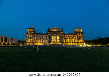 Illuminated Reichstag building in Berlin, Germany at night