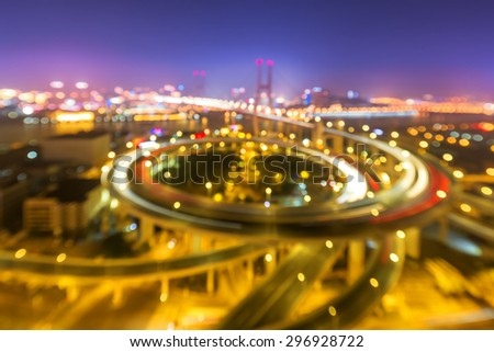 illuminated road intersection and defocus traffic trails - stock photo