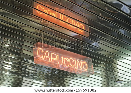 Illuminated sign inside cappuccino bar, catering - stock photo