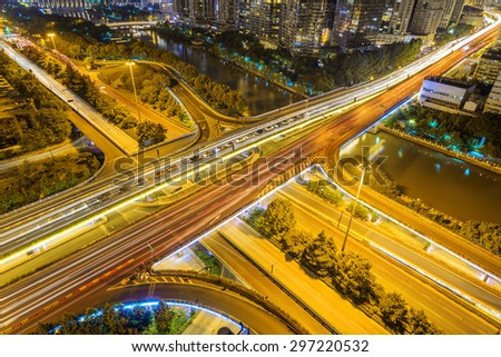 illuminated skyline and road intersection - stock photo