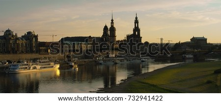 Illuminated skyline of Dresden in the evening light with the Frauenkirche, Hofkirche and excursion boats, Saxony, Jul, 2017