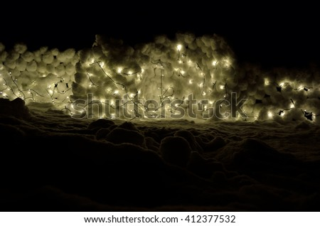 illuminated snowball wall in winter night - stock photo