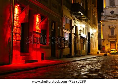 illuminated street at night. Old european city - stock photo
