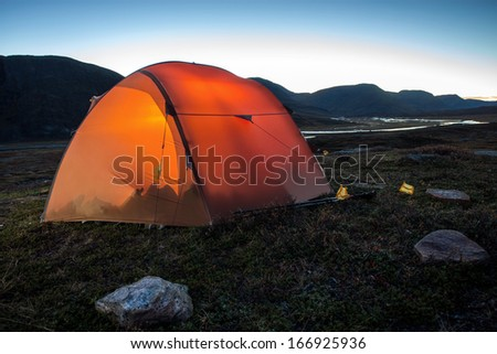 Illuminated Tent after Sunrise - stock photo