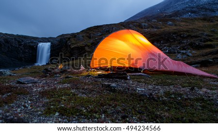 Illuminated Tent in the Night in the Mountains of Sweden - Lapland