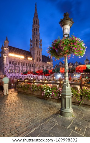 Illuminated Town Hall in Grand Place of Brussels, Belgium at Night. - stock photo
