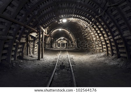 Illuminated, Underground Tunnel in the Mine - stock photo