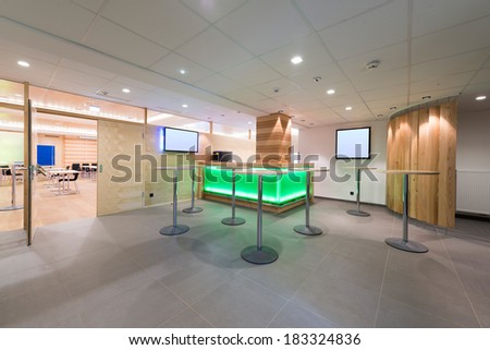 illuminated wooden lounge with tv and stands with bar - stock photo
