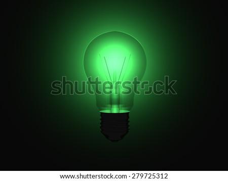 Illuminating green light bulb within a full dark room. - stock photo