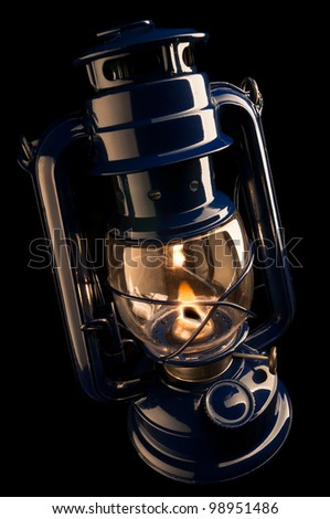 illuminating kerosene lamp on a black background - stock photo