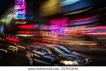 Illumination and night lights in New York City. Image in motion blur style.   - stock photo