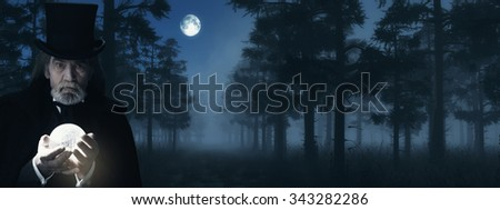 Illusionist Holding Illuminated Sphere in Foggy Winter Forest at Moonlight. - stock photo