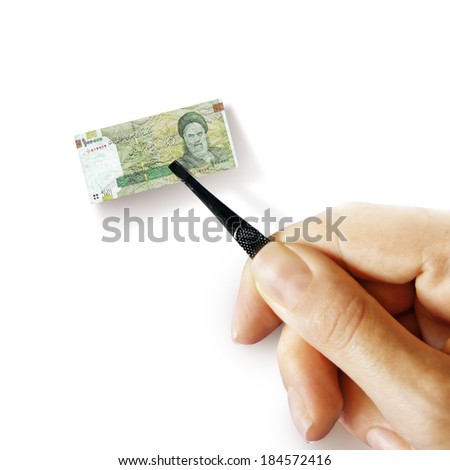 Illustration for inflation - hand with a pincer holding small banknote of Iranian rial, white background - stock photo