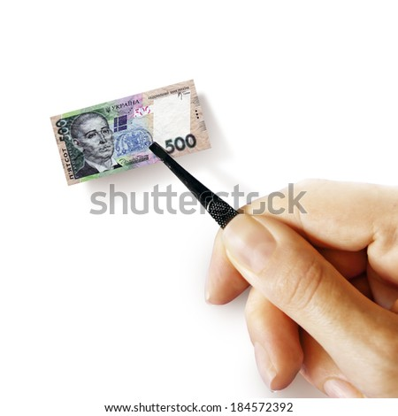 Illustration for inflation - hand with a pincer holding small banknote of Ukrainian hryvnia, white background - stock photo