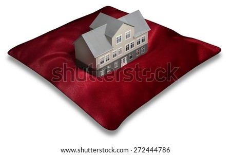 Illustration of a building on top of a red pillow - stock photo