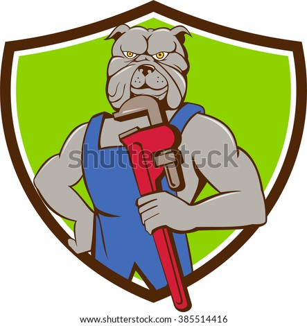 Illustration of a bulldog plumber holding monkey wrench with hand on hips viewed from front set inside shield crest done in cartoon style.