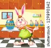 Illustration of a bunny baking an egg-designed cupcakes - stock vector