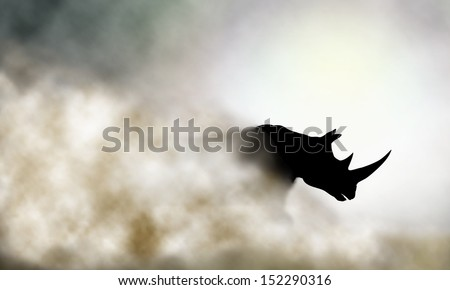 Illustration of a charging rhinoceros and dust cloud - stock photo