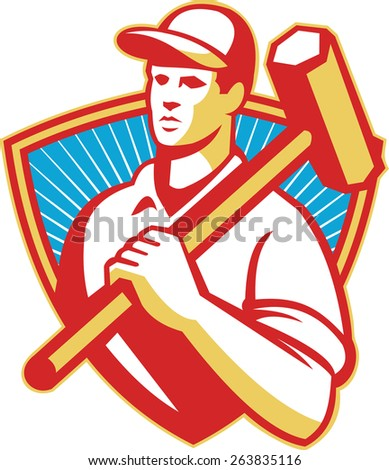 Illustration of a construction worker holding sledgehammer on shoulder set inside shield done in retro style with sunburst in the background. - stock photo
