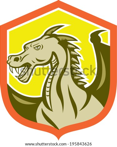 Illustration of a green dragon head set inside shield on isolated white background.
