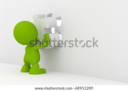 Illustration of a man placing the final piece of a puzzle.  Part of my cute green man series. - stock photo