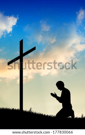 illustration of a man praying under the cross