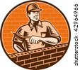 illustration of a Mason worker or brick layer holding a trowel working on brick wall done in woodcut style. - stock photo