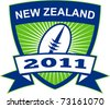"illustration of a rugby ball inside shield with sunburst and words ""New Zealand 2011"" - stock photo"