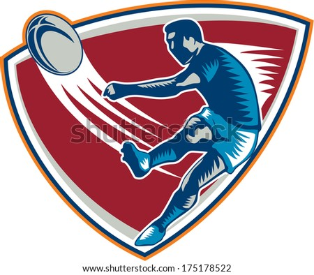 Illustration of a rugby player kicking ball front view set inside shield on isoalated background done in retro woodcut style. - stock photo