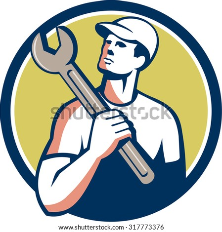 Illustration of a tradesman mechanic wearing hat holding spanner on shoulder looking up to the side set inside circle on isolated background done in retro style.  - stock photo