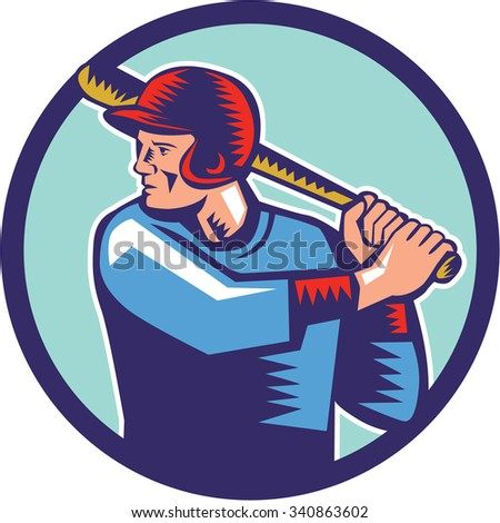 Illustration of an american baseball player batter hitter holding bat batting viewed from the side set inside circle on isolated background done in retro woodcut style.  - stock photo