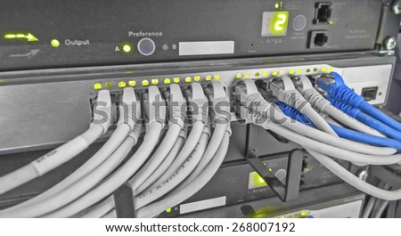 Illustration of data connections and led lights in an industrial building, low aperture used to create low DOF to emphasis focus on connections or lights,