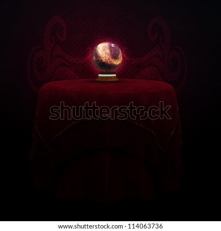 Illustration of magic crystal ball sitting on table in dark room. - stock photo