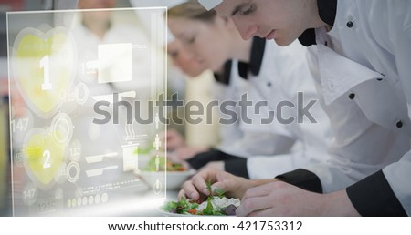 Illustration of numbers on heart shape against culinary class in kitchen making salads - stock photo