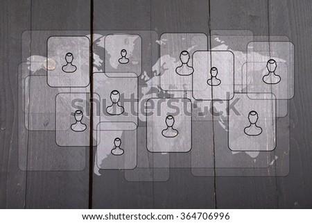 Illustration of people on white world map on dark black wooden background - stock photo