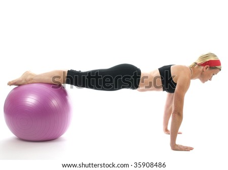 illustration of push ups on fitness core training ball with push up bars by attractive middle age fitness trainer teacher woman exercising and stretching - stock photo
