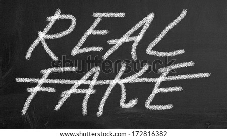 Illustration of real and fake written on black chalkboard - stock photo
