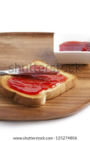 Illustration of strawberry jam sandwich on a wooden board - stock photo