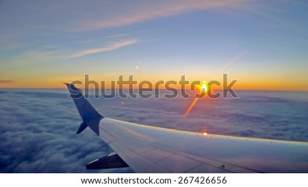 Illustration of View out of a plane window looking across the wing - stock photo