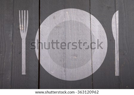 Illustration of white plate with fork and knife on dark black wooden background - stock photo