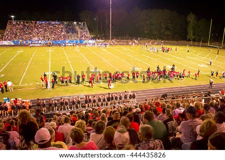 Illustrative image of high school Saturday night football game. - stock photo