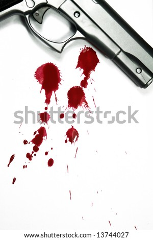 Illustrative styled photograph of a hand gun and blood splatter, on a white background. - stock photo