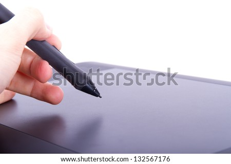 Illustrator or artist hand holding digital pen on graphic tablet, isolated on white background. - stock photo