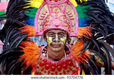 ILOILO, PHILIPPINES –JAN. 22: Street dancer showcases Filipino culture & tradition in Dinagyang Fiesta on January 22, 2012 in Iloilo southern part of the Philippines. - stock photo