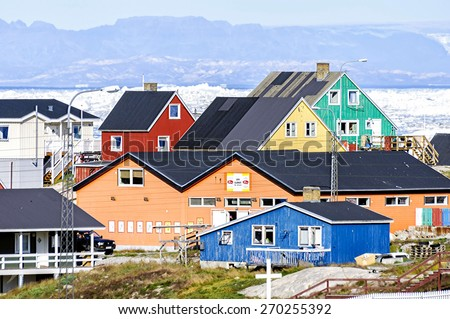 Ilulissat, Greenland - August 18, 2012: View of the colorful building of Ilulissat. Located 350 km north of the Arctic Circle it is the third-largest city in Greenland, after Nuuk and Sisimiut. - stock photo