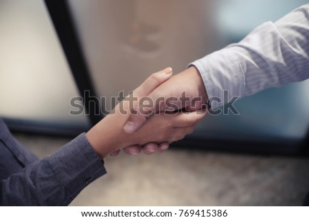 Image business mans handshake. Business partnership meeting concept.