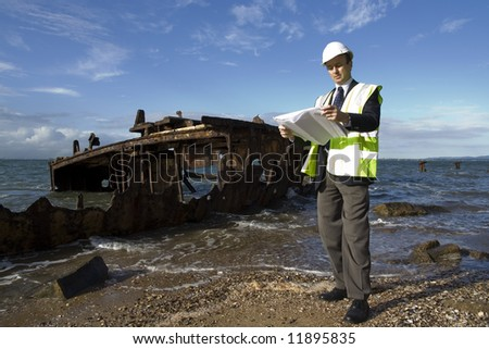 Image depicting a marine surveyor at a ship wreck,hulk,steel,rust,metal,decay,grounded,